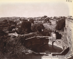 General view looking westwards from the top of the Buland Darwaza towards the modern town, with the Diving Well in the foreground, Fatehpur Sikri